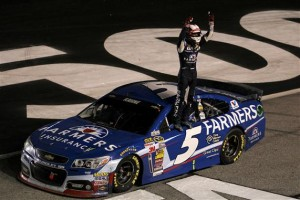 Kasey Kahne, driver of the #5 Farmers Insurance Chevrolet, celebrates after winning the NASCAR Sprint Cup Series Oral-B USA 500 at Atlanta Motor Speedway on August 31, 2014 in Hampton, Georgia.  Photo by Todd Warshaw/NASCAR via Getty Images