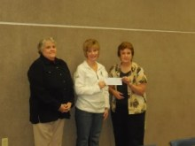 Amanda Steeb, Operation Roundup Trust Coordinator presents a grant check    to Wendy Elam and Linda Molenda, Drug and Tobacco Free Starke County Coordinators.