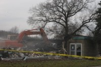 A volunteer contractor takes down the Washington Township School