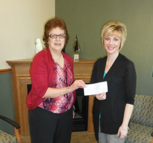 CADA Executive Director Wendy Elam accepts an Operation Round Up donation from Kankakee Valley REMC Communications/Marketing Director Amanda Steeb.