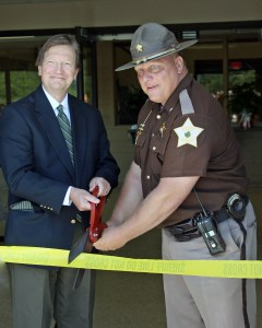 Starke Circuit Judge Kim Hall and Starke County Sheriff Bill Dulin prepare to cut the ribbon to officially open the Starke County Sheriff's Office and Detention Center