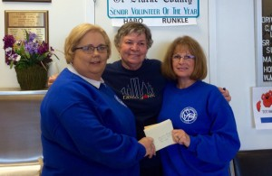 St. Vincent de Paul Society Members Mary Kleinfehn, Roseanne VonBampus and Linda Kelly as Mary and Linda prepare to deliver the gift cards.