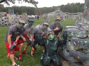 WKVI's Mary Perren surrenders to four members of the Knox High School Football team after her paintball firing squad at Fort Knox Paintball.