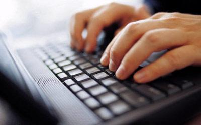Typing on Laptop_25614