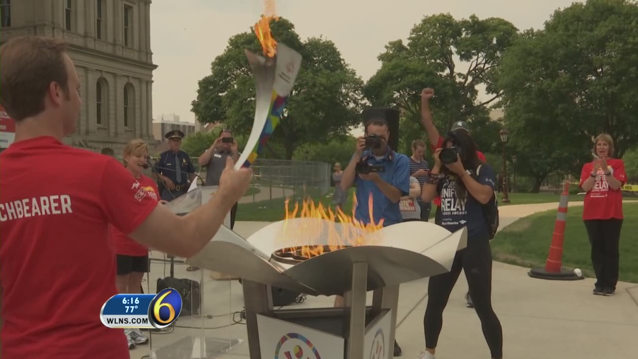 Special Olympics torch passes through Lansing