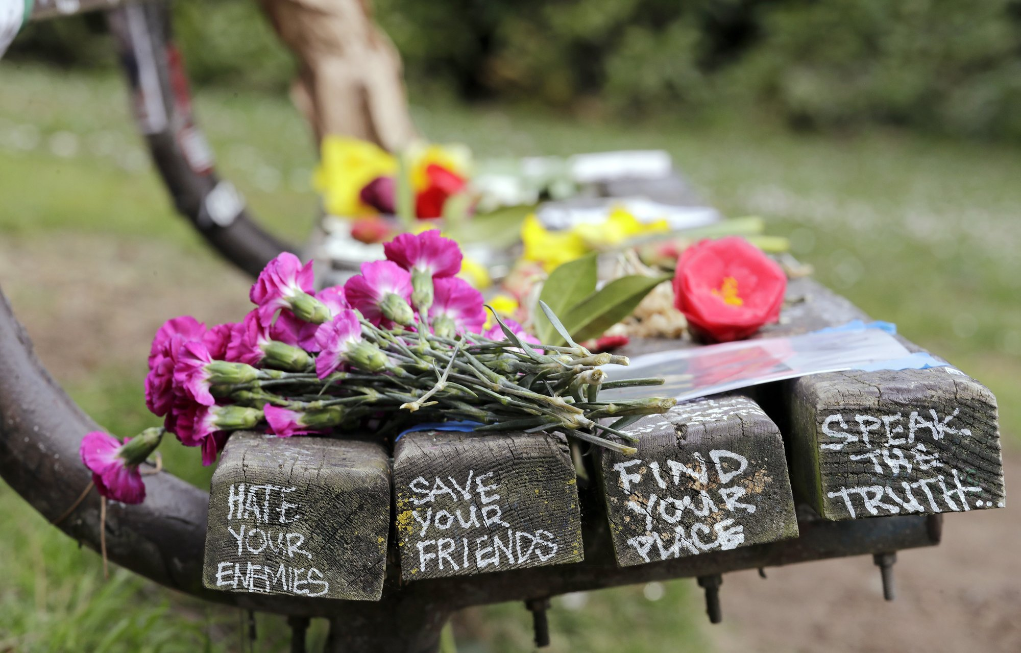 Flowers honoring the late Kurt Cobain appear on a park bench in Seattle_1554498439365.jpeg.jpg