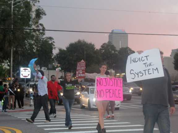 Orlando protesters block traffic at the intersection of Magnolia and Colonial. Photo by Renata Sago, WMFE