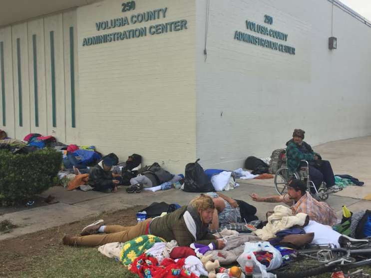 Nearly 90 homeless men and women are camping outside of the Volusia County Administration Center in Daytona Beach. Photo: Renata Sago.
