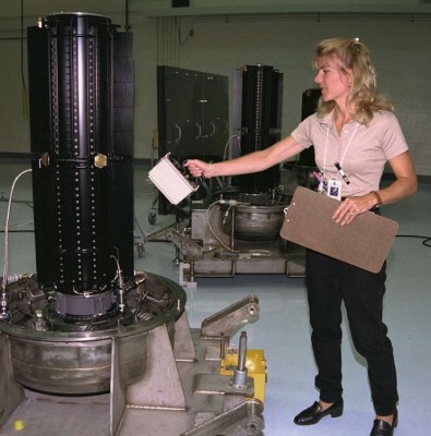 A technician measures the radiation output on one of three RTGs used in the Cassini spacecraft. (1997) Photo: NASA