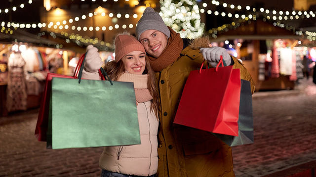 holidays, christmas and people concept - happy couple at with sh_505463