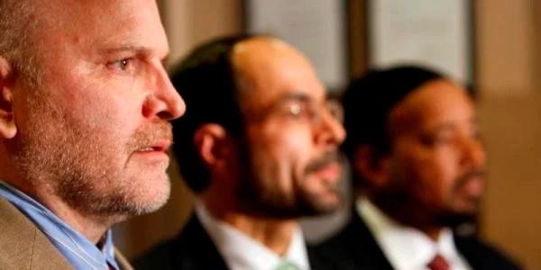 CAIR Communications Director Ibrahim Hooper, left, and CAIR Executive Director Nihad Awad, center.