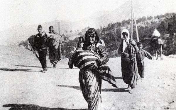 An Armenian woman forced to march in the desert carrying her child