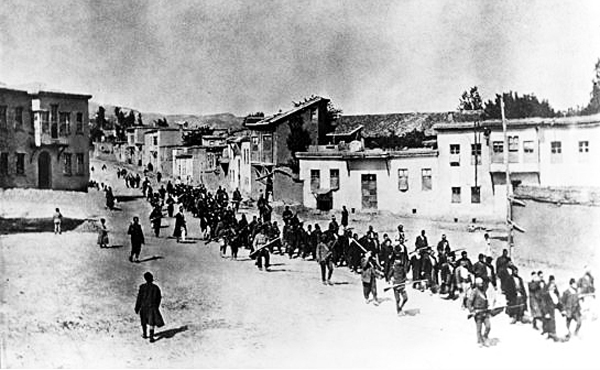 Ottoman Armenians are marched to a prison in Kharpert, Armenia, by armed Turkish soldiers in April 1915. Up to 1.5 million Armenians were killed in what is now recognized as the 20th century's first genocide.