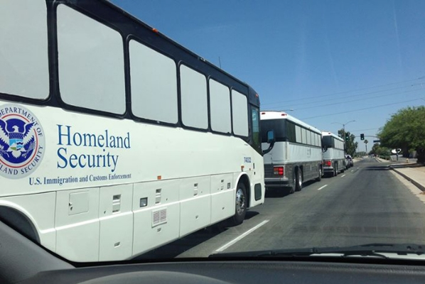 DHS buses carry immigrants from the border to detention centers where they are processed, given a court date and released.