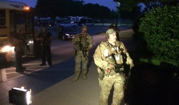 Garland SWAT officers prepare to evacuate attendees Sunday night (WND photo)