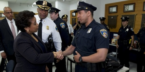 "U.S. Attorney General Loretta Lynch, shown here with Baltimore police, announced the new ""Strong Cities Network"" to plug local departments into international cooperation and ""shared resources"" with their peers across the globe."
