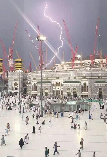 Lightning strikes the crane just before it collapses on the Grand Mosque in Mecca, Saudi Arabia.