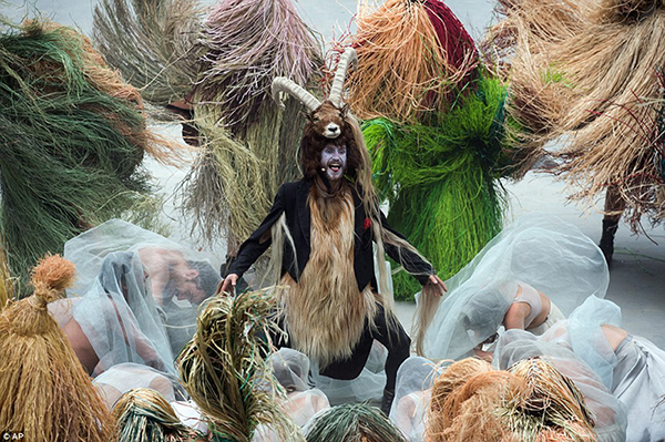 A goatman takes over as master of ceremonies while the other participants bow down and worship him.