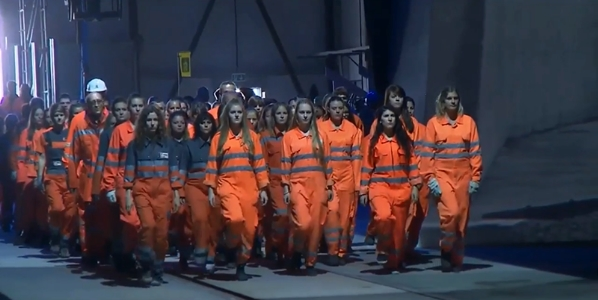 Robotic worker bees march through rail tunnel as if pre-programmed by an exterior force during recent ceremony christening Europe's historic rail tunnel.