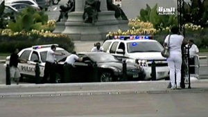 U.S. Capitol Police officers and Secret Service agents surround Miriam Carey's car near the Capitol Oct. 3, 2013