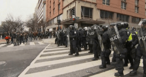 Police monitor protesters in Washington on Jan. 20