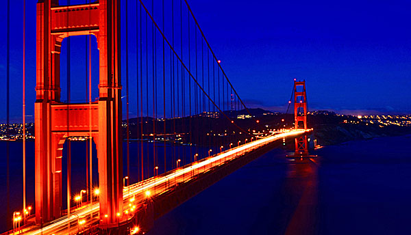 A long exposure of the Golden Gate Bridge right after sunset. The cold waters of the San Francisco Bay remain calm as the late night traffic goes on.