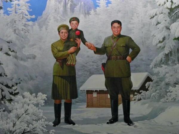 Propaganda poster of Kim Il-sung with his wife Kim Jong-suk and son Kim Jong-il