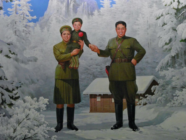 Propaganda poster of Kim Il-sung with his wife Kim Jong-suk and son Kim Jong-il