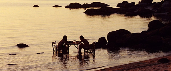 Two Israeli soldiers play chess at sunset amid the calm of Angel's Bay (Photo: Anthony C. LoBaido)