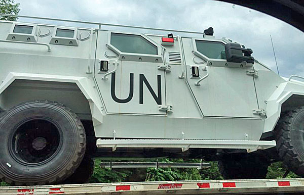 Bloggers were quick to point out the curiosity of U.N. trucks being transported on U.S. highways