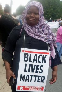 WWP activist wears Black Lives Matter placard (Photo: Facebook/Howard Rotman)
