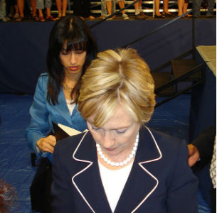 Aide Huma Abedin trails Hillary Clinton at an event in Henderson, Nevada (Wikimedia Commons)