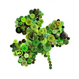 St Patricks Day shamrock of green buttons over a white background