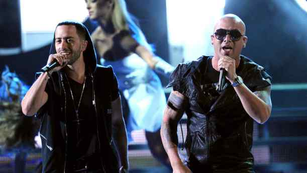LAS VEGAS, NV - NOVEMBER 10: Wisin Y Yandel perform onstage during the 12th annual Latin GRAMMY Awards at the Mandalay Bay Events Center on November 10, 2011 in Las Vegas, Nevada. (Photo by Kevin Winter/Getty Images for Latin Recording Academy)