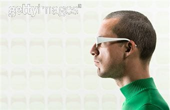 A Man in Glasses Staring...