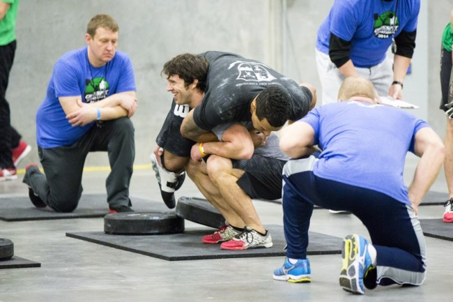 CrossFit ®* Fort Vancouver Invitational 2014, Adam Neiffer doing the buddy squat with Jerome Perryman...and apparently enjoying it
