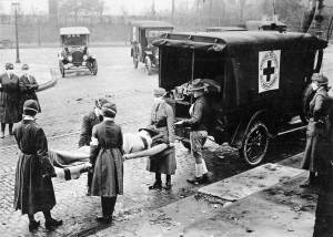 Red Cross members remove victim of Spanish Flu from home in St. Louis, Missouri, USA.