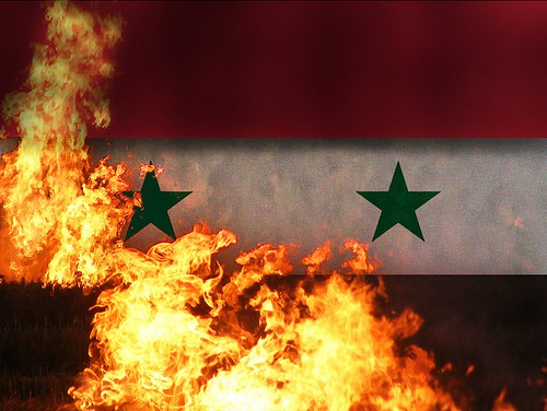 Syria flag fire