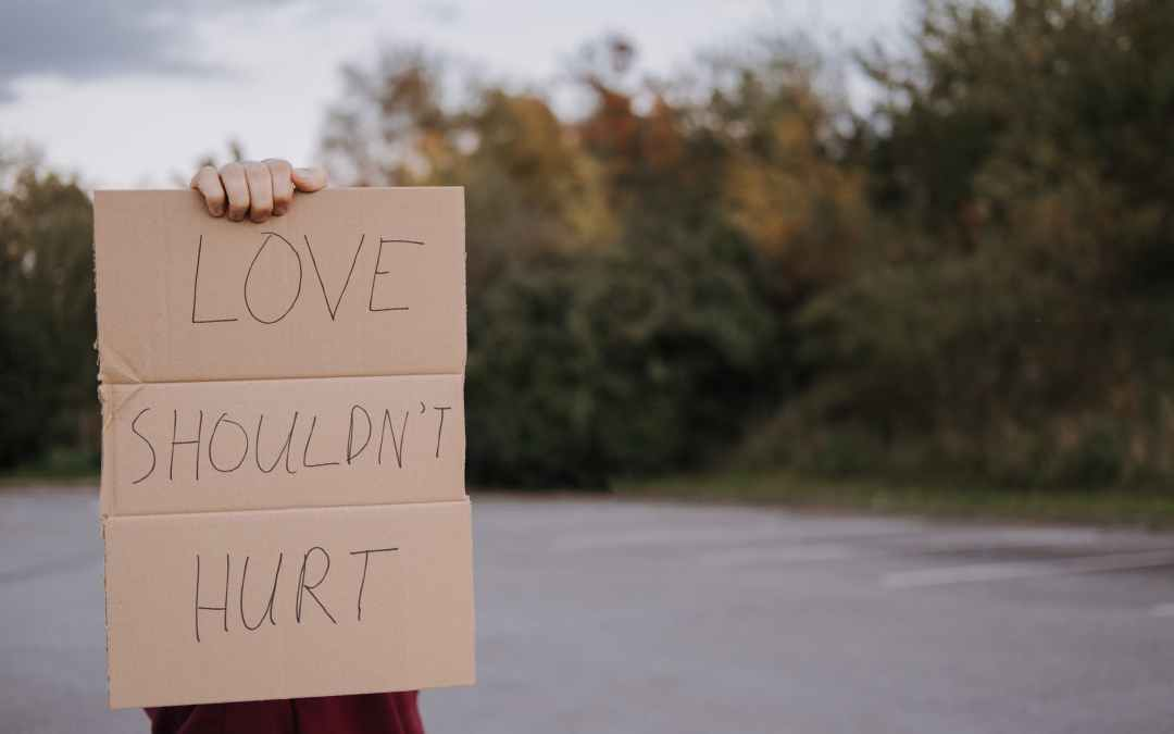person with carton with inscription love should not hurt