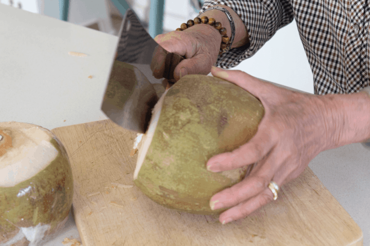 Chopping coconuts on a board