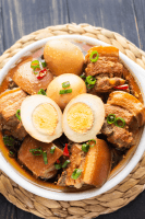Vietnamese Braised Pork Belly in a bowl with a hard boiled egg cut open