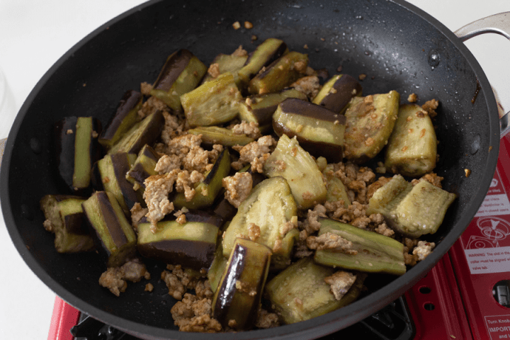 Combined eggplant and pork mince in a wok