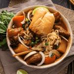 Half a baguette in Vietnamese beef stew