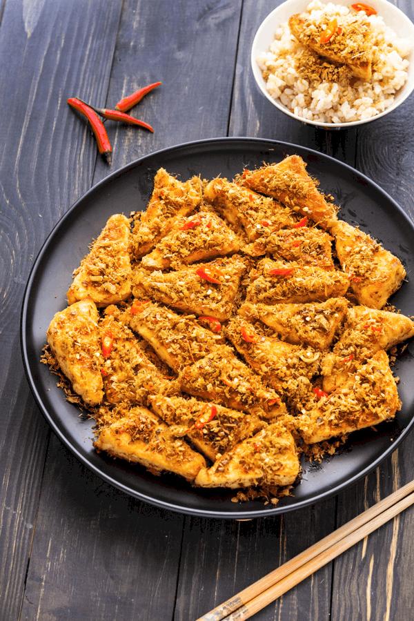 Fried Lemongrass Tofu on a plate with chopsticks and rice