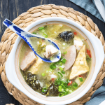 Fish soup in a bowl with a soup spoon