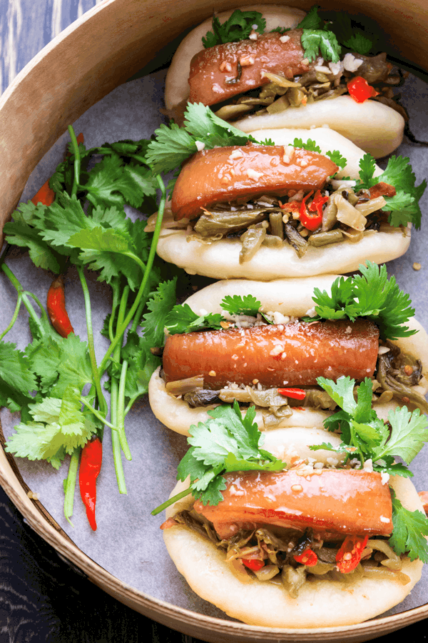 Pork belly baos in a bamboo steamer