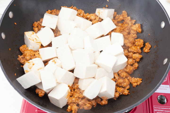 Tofu cubes in a wok with pork mince