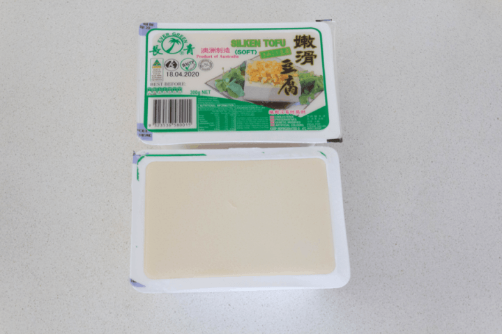 Silken tofu in a containers opened and unopened