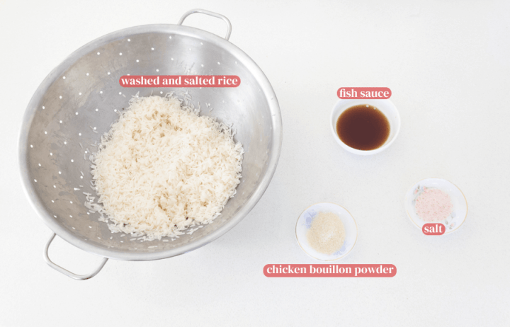 Rice in a colander with fish sauce and chicken bouillon powder in dishes