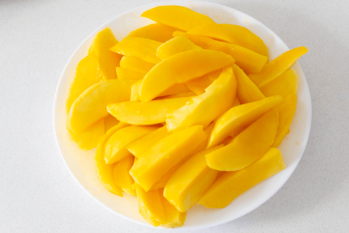Sliced mango strips on a plate